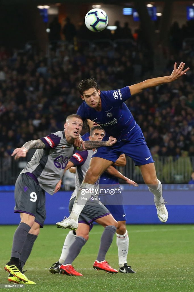 Marcos Alonso of Chelsea heads the ball against Andy Keogh of the Glory during the international friendly between Chelsea FC and Perth Glory at Optus Stadium on July 23, 2018 in Perth, Australia.