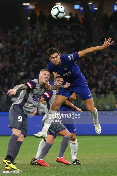 Marcos Alonso of Chelsea heads the ball against Andy Keogh of the Glory during the international friendly between Chelsea FC and Perth Glory at Optus...