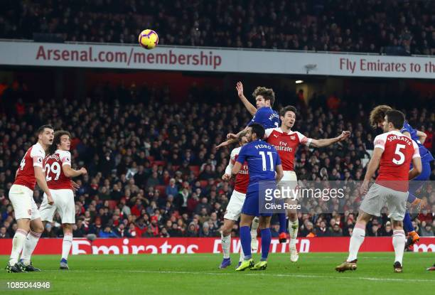 Marcos Alonso of Chelsea heads the ball under pressure from Laurent Koscielny of Arsenal which hits the posts during the Premier League match between...