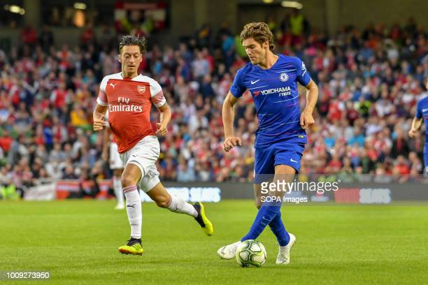 Marcos Alonso of Chelsea Holds off Mesut Ozil of Arsenal during the Chelsea v Arsenal International Champions Cup in Aviva Stadium