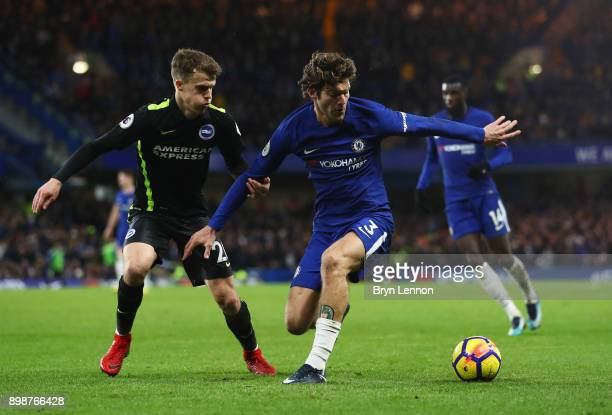 Marcos Alonso of Chelsea holds off Solly March of Brighton and Hove Albion of Brighton and Hove Albion during the Premier League match between...