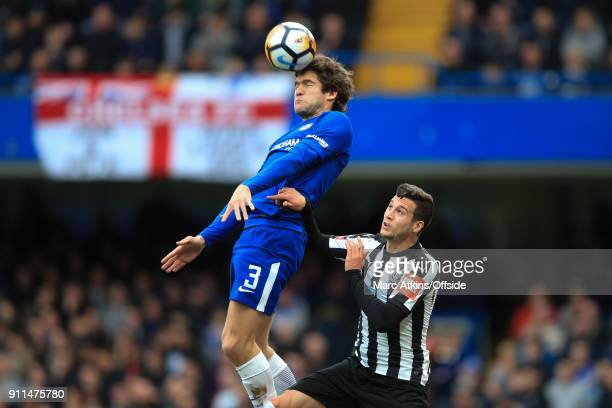 Marcos Alonso of Chelsea in action with Javier Manquillo of Newcastle United during the FA Cup 4th Round match between Chelsea and Newcastle United...