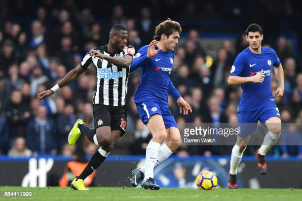 Marcos Alonso of Chelsea is challenged by Chancel Mbemba of Newcastle United during the Premier League match between Chelsea and Newcastle United at...