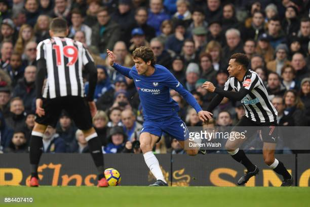 Marcos Alonso of Chelsea is challenged by Jacob Murphy of Newcastle United during the Premier League match between Chelsea and Newcastle United at...