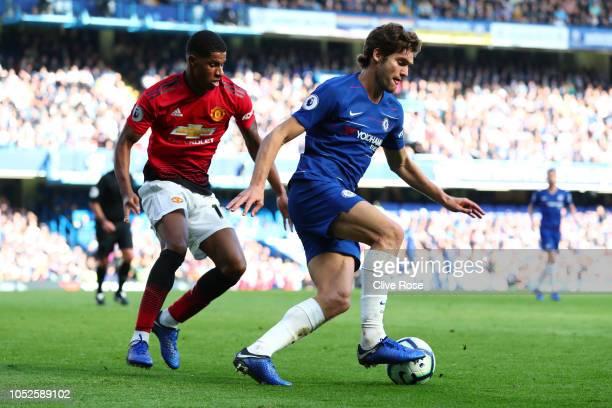 Marcos Alonso of Chelsea is challenged by Marcus Rashford of Manchester United during the Premier League match between Chelsea FC and Manchester...