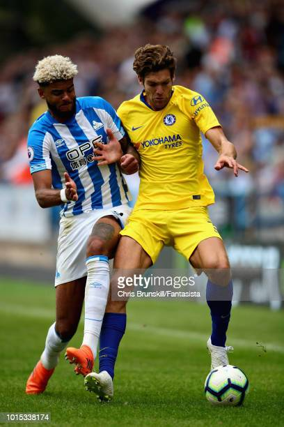Marcos Alonso of Chelsea is challenged by Philip Billing of Huddersfield Town during the Premier League match between Huddersfield Town and Chelsea...