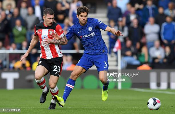 Marcos Alonso of Chelsea is challenged by PierreEmile Hojbjerg of Southampton during the Premier League match between Southampton FC and Chelsea FC...