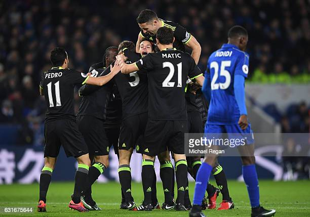 Marcos Alonso of Chelsea is congratulated by teammates after scoring the opening goal during the Premier League match between Leicester City and...