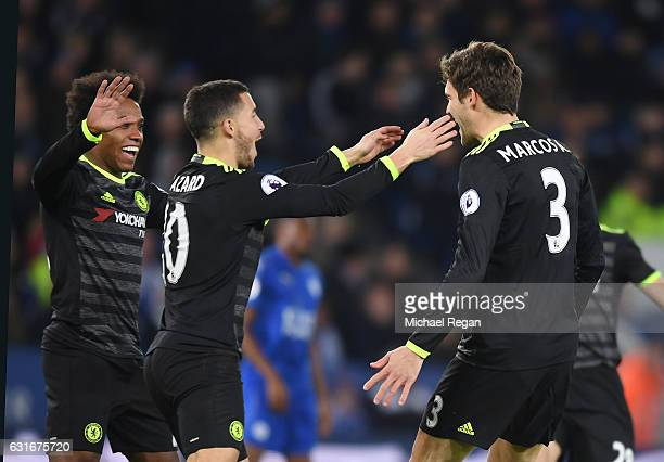 Marcos Alonso of Chelsea is congratulated by teammates Willian and Eden Hazard after scoring the opening goal during the Premier League match between...