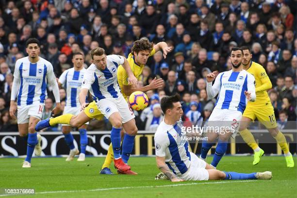 Marcos Alonso of Chelsea is crowded out by the Brighton defence during the Premier League match between Brighton Hove Albion and Chelsea FC at...