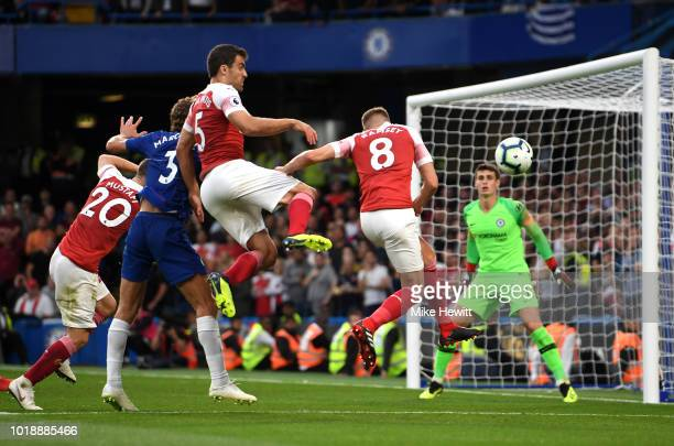 Marcos Alonso of Chelsea is pressured by Shkodran Mustafi Sokratis Papastathopoulos and Aaron Ramsey of Arsenal during the Premier League match...