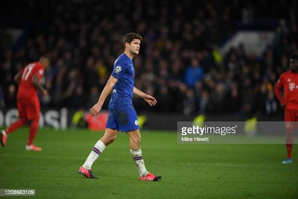 Marcos Alonso of Chelsea leaves the pitch after being shown a redcard during the UEFA Champions League round of 16 first leg match between Chelsea FC...