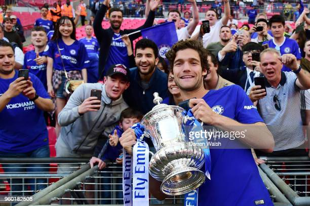 Marcos Alonso of Chelsea poses with the Emirates FA Cup trophy following his side's win during The Emirates FA Cup Final between Chelsea and...