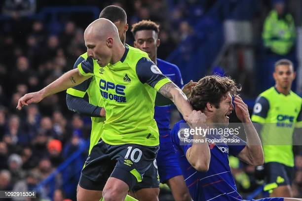 Marcos Alonso of Chelsea reacts after challenge with Aaron Mooy of Huddersfield Town during the Premier League match between Chelsea FC and...
