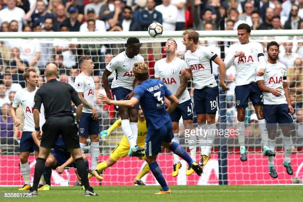 Marcos Alonso of Chelsea scores his sides first goal during the Premier League match between Tottenham Hotspur and Chelsea at Wembley Stadium on...