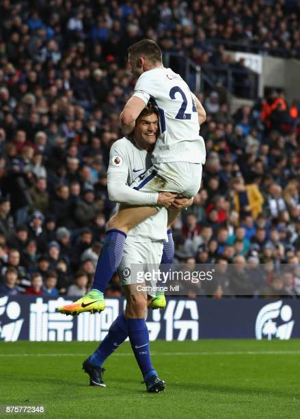 Marcos Alonso of Chelsea scores his side's third goal with his team mate Gary Cahill during the Premier League match between West Bromwich Albion and...