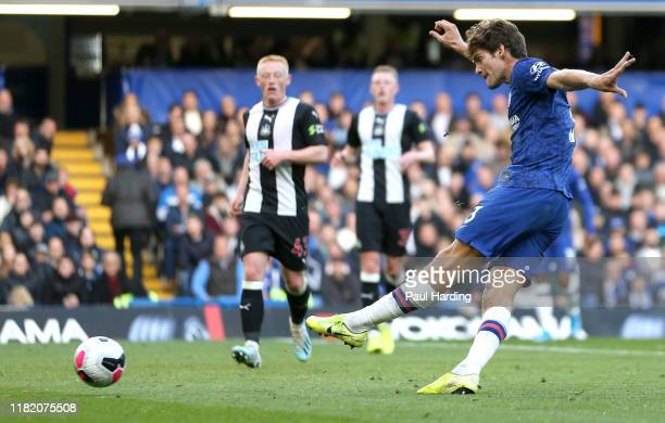 Marcos Alonso of Chelsea scores his team's first goal during the Premier League match between Chelsea FC and Newcastle United at Stamford Bridge on...