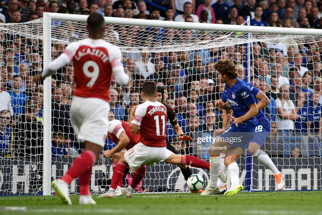 Marcos Alonso of Chelsea scores his team's third goal during the Premier League match between Chelsea FC and Arsenal FC at Stamford Bridge on August 18, 2018 in London, United Kingdom.