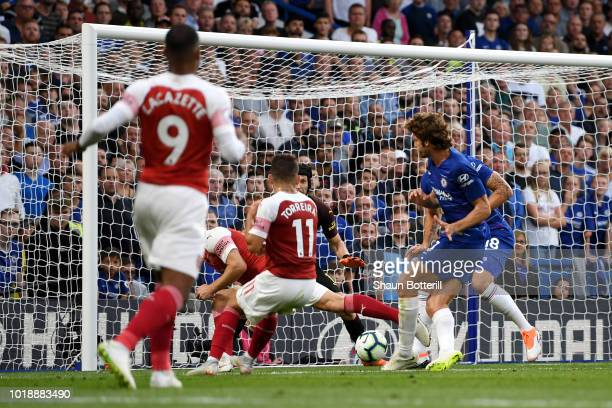 Marcos Alonso of Chelsea scores his team's third goal during the Premier League match between Chelsea FC and Arsenal FC at Stamford Bridge on August...