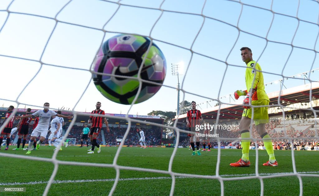 Marcos Alonso (obscured) of Chelsea scores his team's third goal during the Premier League match between AFC Bournemouth and Chelsea at Vitality Stadium on April 8, 2017 in Bournemouth, England.