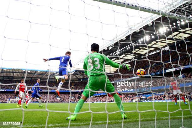 Marcos Alonso of Chelsea scores the opening goal past Petr Cech of Arsenal during the Premier League match between Chelsea and Arsenal at Stamford...