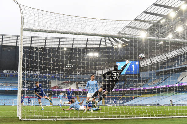 Marcos Alonso of Chelsea scores their side's second goal past Ederson of Manchester City during the Premier League match between Manchester City and...