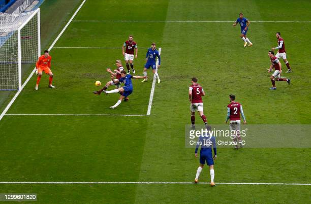 Marcos Alonso of Chelsea scores their side's second goal past Nick Pope of Burnley whilst under pressure from Ben Mee of Burnley during the Premier...