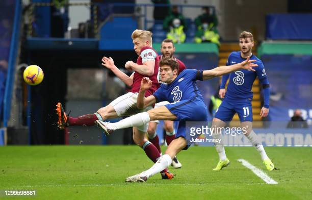 Marcos Alonso of Chelsea scores their side's second goal whilst under pressure from Ben Mee of Burnley during the Premier League match between...