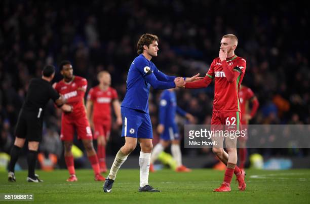 Marcos Alonso of Chelsea shake hands with Oliver McBurnie of Swansea City after the Premier League match between Chelsea and Swansea City at Stamford...