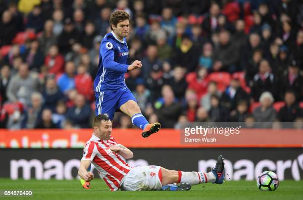 Marcos Alonso of Chelsea shoot past Phil Bardsley of Stoke City during the Premier League match between Stoke City and Chelsea at Bet365 Stadium on...