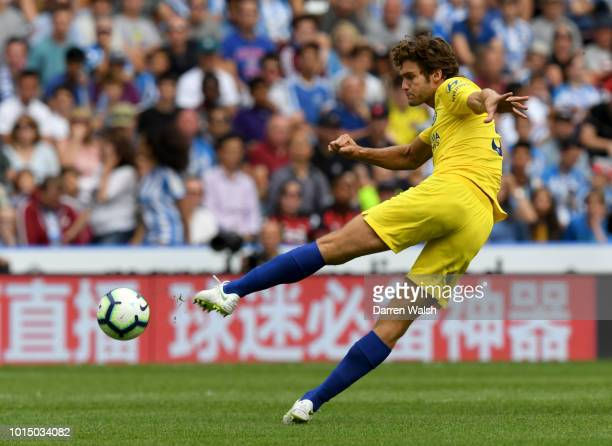 Marcos Alonso of Chelsea shoots during the Premier League match between Huddersfield Town and Chelsea FC at John Smith's Stadium on August 11 2018 in...
