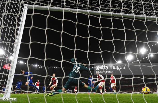 Marcos Alonso of Chelsea shoots past Petr Cech of Arsenal to score his sides second goal during the Premier League match between Arsenal and Chelsea...