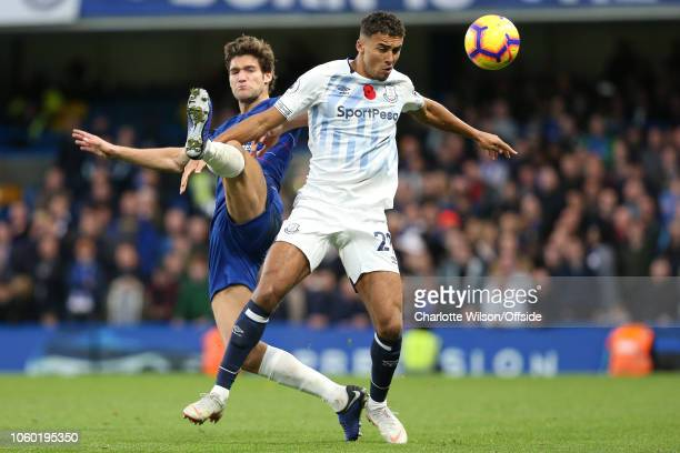 Marcos Alonso of Chelsea stretches past Dominic CalvertLewin of Everton during the Premier League match between Chelsea FC and Everton FC at Stamford...