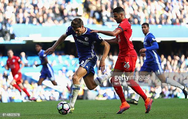 Marcos Alonso of Chelsea tackles Riyad Mahrez of Leicester City during the Premier League match between Chelsea and Leicester City at Stamford Bridge...