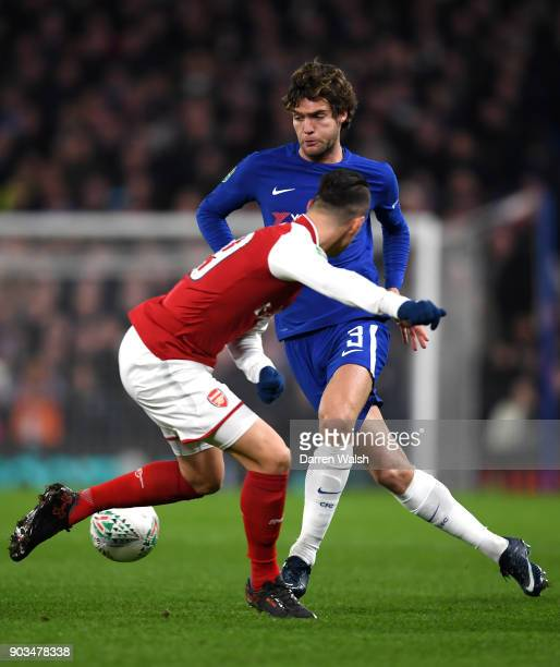 Marcos Alonso of Chelsea takes on Granit Xhaka of Arsenal during the Carabao Cup SemiFinal First Leg match between Chelsea and Arsenal at Stamford...