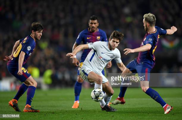 Marcos Alonso of Chelsea takes on Sergi Roberto, Paulinho and Ivan Rakitic of Barcelona during the UEFA Champions League Round of 16 Second Leg match...