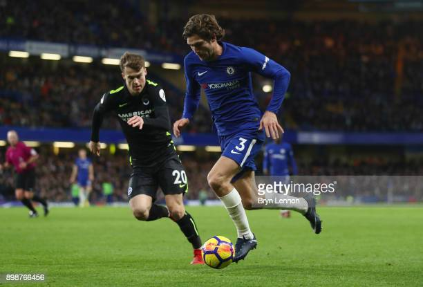 Marcos Alonso of Chelsea takes on Solly March of Brighton and Hove Albion of Brighton and Hove Albion during the Premier League match between Chelsea...