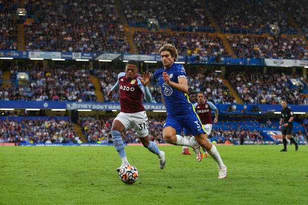 Marcos Alonso of Chelsea vies for possession with Leon Bailey of Aston Villa during the Premier League match between Chelsea and Aston Villa at...
