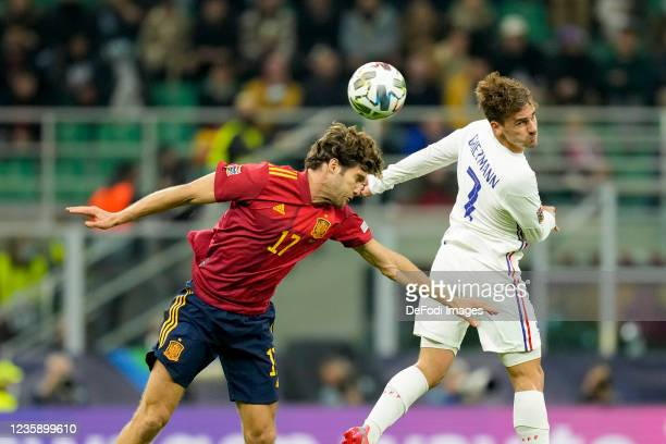 Marcos Alonso of Spain and Antoine Griezmann of France battle for the ball during the UEFA Nations League Final match between the Spain and France at...