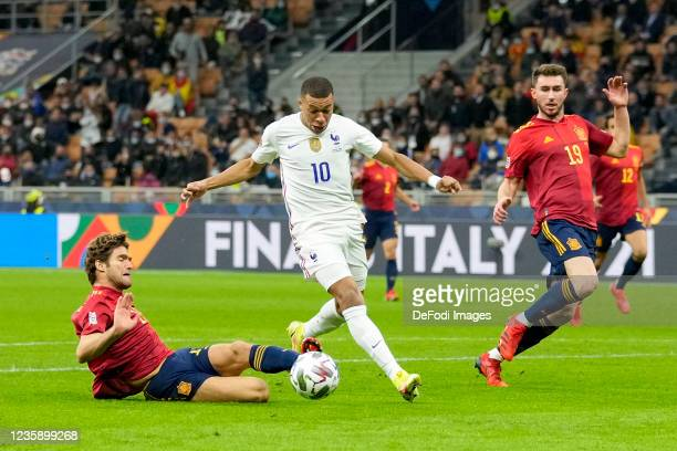 Marcos Alonso of Spain and Kylian Mbappe of France battle for the ball during the UEFA Nations League Final match between the Spain and France at San...