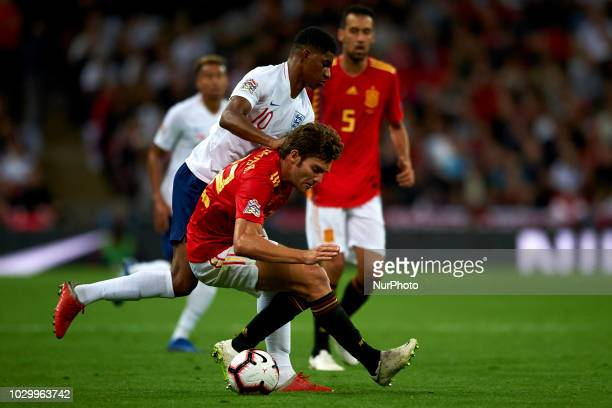 Marcos Alonso of Spain and Marcus Rashford of England battle for the ball during the UEFA Nations League football match between England and Spain at...