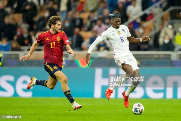 Marcos Alonso of Spain and Paul Pogba of France battle for the ball during the UEFA Nations League Final match between the Spain and France at San...