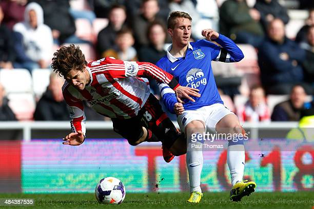 Marcos Alonso of Sunderland in action with Gerard Deulofeu of Everton during the Barclays Premier League match between Sunderland and Everton at the...