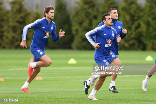 Marcos Alonso Pedro and Mateo Kovacic of Chelsea during the afternoon training session at Chelsea Training Ground on August 28 2018 in Cobham England