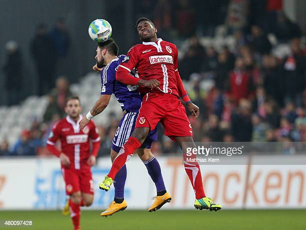 Marcos Alvarez of Osnabrueck and Ebewa Yam Mimbala of Cottbus jump for a header during the third league match between FC Energie Cottbus and VFL...