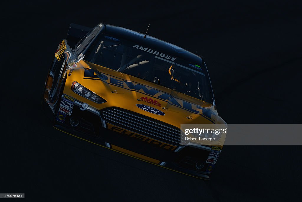 Marcos Ambrose, driver of the #9 DeWalt Ford, drives during qualifying for the NASCAR Sprint Cup Series Auto Club 400 at Auto Club Speedway on March 21, 2014 in Fontana, California.