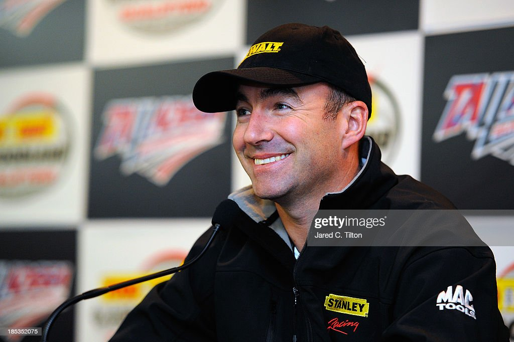 Marcos Ambrose, driver of the #9 DeWalt Ford, speaks during a press conference after qualifying for the NASCAR Sprint Cup Series 45th Annual Camping World RV Sales 500 at Talladega Superspeedway on October 19, 2013 in Talladega, Alabama.