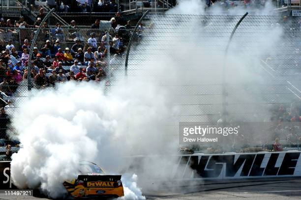 Marcos Ambrose, driver of the Dewalt Ford, spins into the wall after an incident in the NASCAR Sprint Cup Series Goody's Fast Relief 500 at...