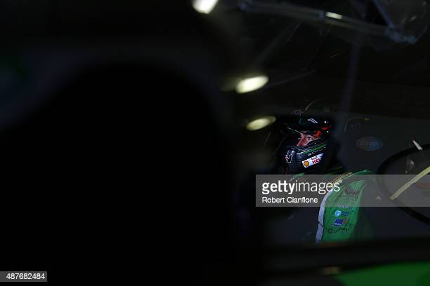 Marcos Ambrose driver of the DJR Team Penske Ford sits in the car prior to practice for the Sandown 500, which is part of the V8 Supercars...