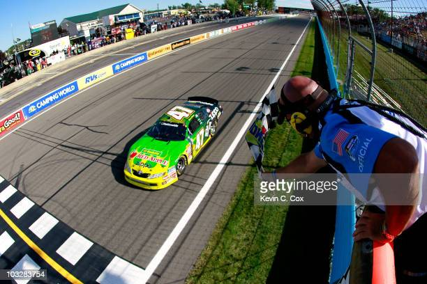 Marcos Ambrose, driver of the Kwik Fil/Zippo Chevrolet, crosses the finish line to win the NASCAR Nationwide Series Zippo 200 at Watkins Glen...
